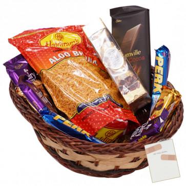 Sweet n Spicy Basket -  Haldiram Namkeen, Ferrero Rocher 4 pcs, 2 Perk, 1 Bournville, 1 Twix, 1 Bounty, 1 Cadbury Dairy Milk Crackle, 1 5 Star, 2 Cadbury Dairy Milk Silk & Card
