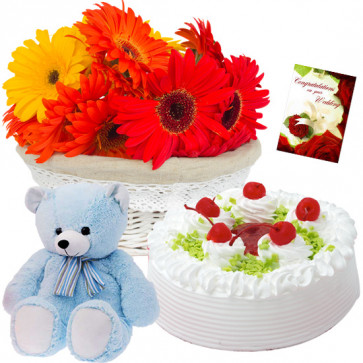 "Colorful Gift - 24 Red & Yellow Gerberas in Basket, Vanila Cake 1/2 kg, Teddy 6"" and Card"