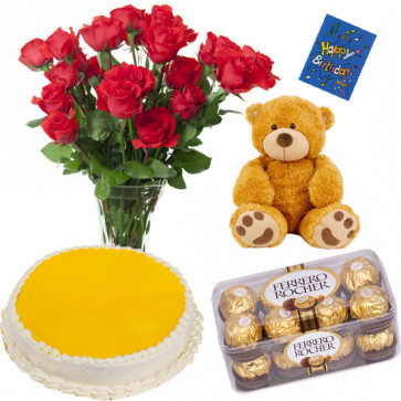 """Wonderful Surprise - Pinapple Cake 1/2 kg, 12 Red Roses in Vase, 16 pcs Ferrero Rocher, Teddy 6"""" and card"""