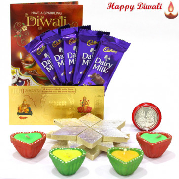 Kaju Sweet Hamper - Kaju Katli 250 gms, 5 Dairy Milk Bars, 24 Carat Gold Plated Dhan Laxmi Varsha Note with 4 Diyas and Laxmi-Ganesha Coin