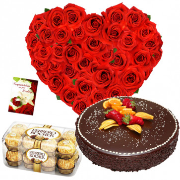 Pure Affection - 50 Red Roses in Heart Shaped Arrangement, 1/2 kg Chocolate Cake, Ferrero Rocher 16 pcs + Card
