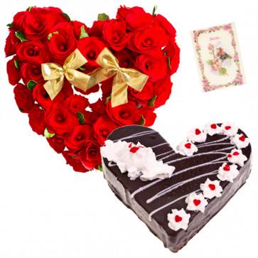 Warm Wishes - 50 Red Roses Heart Shaped Arrangement, 1 Kg Black Forest Cake Heart Shape + Card