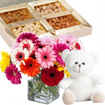 Teddy with Gerberas - 15 Mix Gerberas Vase, Assorted Dryfruits in Box 200 gms, Teddy 6 inch & Card
