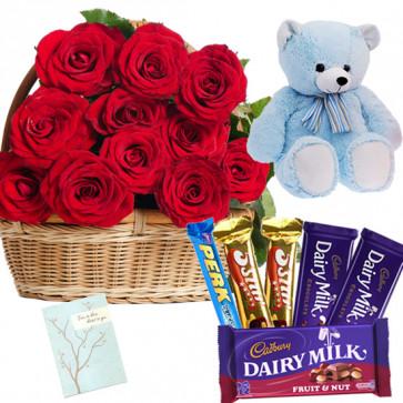 Rosy Teddy Hamper - 25 Red Roses Basket, Teddy 6 inch, Assorted Cadbury Hamper + Card
