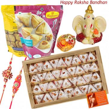 Sweets for Bro - Kaju Pan, 2 Haldiram Namkeen, Ganesh Idol with 2 Rakhi and Roli-Chawal