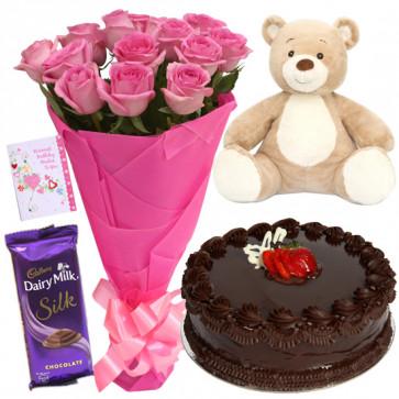 Lovely N Sweet - 10 Pink Roses, 1/2 Kg Cake, Dairy Milk Silk, Teddy 6 inch + Card