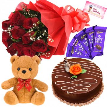 Teddy Joy - 10 Red Roses + Teddy 6 inch + Half KG Cake + 5 Dairy Milk + Card