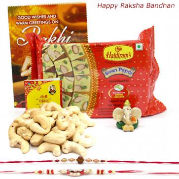Papdi Ganesh - Cashewnuts 100 gms, Haldiram Soan Papdi, Ganesh Idol with 2 Rakhi and Roli-Chawal