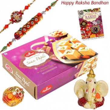 Soan Papdi Delight -  Soan Papdi, Ganesh Idol with 2 Rakhi and Roli-Chawal