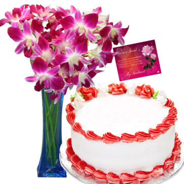 Meaningful Combo - 12 Pink Orchids In A Glass Vase + 1/2 Kg Strawberry Cake + Card
