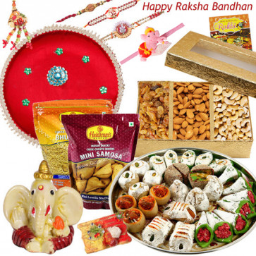 Love for Brother - Kaju Mix 1 Kg, Assorted Dryfruit Box 400 gms, 2 Haldiram Namkeen 150 gms each, Ganesh Idol, Puja Thali (R) with Set of 5 Rakhis(1 Sandalwood, 1 Auspicious, 1 Pearl, 1 Kids Rakhi and 1 Lumba Rakhi) and Roli-Chawal