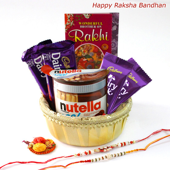 Chocolates All Around - Nutella Ferrero & Go, 2 Cadbury Dairy Milk Fruit &  Nut, 2 Dairy Milk (M) with 2 Rakhi and Roli-Chawal