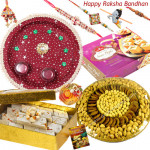 Brother's Delight -  Kaju Katli 500 gms, Assorted Dryfruit Basket 500 gms, Soan Papdi 500 gms, Puja Thali (M) with Set of 5 Rakhis(1 Sandalwood, 1 Auspicious, 1 Pearl, 1 Kids Rakhi and 1 Lumba Rakhi) and Roli-Chawal