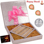 Sweet n Spicy Gift - Kaju Katli 500 gms & Assorted Namkeen 500 gms  in a decorative box with 2 Diyas and Laxmi-Ganesha Coin