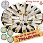 Celebration - Kaju Pista Roll 250 gms, 2 Toblerone with 4 Diyas and Laxmi-Ganesha Coin