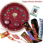 Chocolate Trip Thali - Puja Thali (M), Snickers, Mars, Twix, Bounty with 2 Fancy Rakhis and Roli-Chawal
