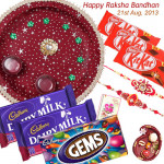 Impressive Combo - Puja Thali (M), Fruit & Nut 2 pcs, 3 Kitkat , 1 Gems with 2 Fancy Rakhis and Roli-Chawal