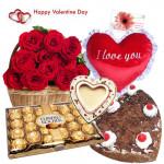 Lovely Valentine Surprise - 25 Red Roses Basket + Black Forest Heart Cake 1 kg + Photo Frame + Heart Shape Pillow + Ferrero Rocher 24 Pcs + Card