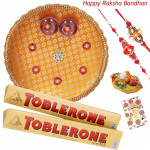 Wonder Combo Thali - Puja Thali (O), Toblerone 2 pcs with 2 Fancy Rakhis and Roli-Chawal