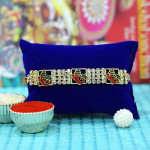 Elegant Triple Ganesha Diamond Rakhi