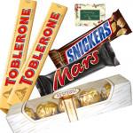 2 Toblerone 60 gms, 1 Ferrero Rocher 5 pcs each, 1 Snicker, 1 Mars