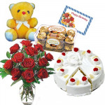"Wonderful Surprise - Pinapple Cake 1/2 kg, 12 Red Roses in Vase, 16 pcs Ferrero Rocher, Teddy 6"" and card"