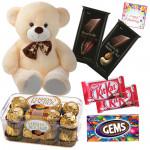 Chocolaty Teddy - Teddy 8 inch, 2 Bournville30 gms each, Ferrero Rocher 16 pcs, 2 Kitkat, Gems & Card
