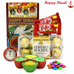 Delightful Hamper - Ferrero Rocher 16 pcs, 2 Kitkat , 1 Gems with 4 Diyas and Laxmi-Ganesha Coin