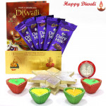 Kaju Sweet Hamper - Kaju Katli 250 gms, 5 Dairy Milk Bars, 24 Carat Gold Plated Dhan Laxmi Varsha Note with 4 Diyas and Laxmi-Ganesha Coin