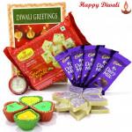 Double Combo - Kaju Katli 250 gms, Haldiram Soan Papdi 250 gms, 5 Dairy Milk Bars with 4 Diyas and Laxmi-Ganesha Coin