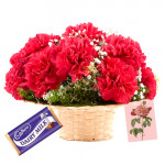 Sweet Sentiments - 10 Red Carnations Basket + Dairy Milk + Card