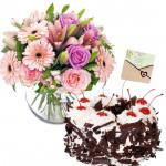 Pleasing Hamper - 12 Pink Flowers in Vase, 1/2 Kg Black Forest Cake + Card