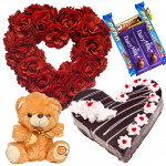 Superior Combo - 50 Red Roses Heart Shaped Arrangement, 1.5 Kg Black Forest Cake Heart Shape, Teddy bear 6 inch, 5 Assorted Bars + Card