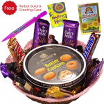 Holi Chocolates - Danish Butter Cookies, 1 5 Star, 1 Mars, 1 Twix, 1 Cadbury Dairy Milk Crackle, 3 Cadbury Dairy Milk Silk, 1 Snickers, Pichkari, Herbal Gulal & Greeing Card