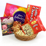 Relishing Hamper - Cashewnuts in Potli, Cadbury Celebrations, Soan Papdi 250 gms, Chocopie, Basket