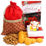 Impressive Hamper - Almond in Potli (D), Kesar Peda 250 gms, Decorative Ganesh Idol