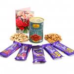 Eminent Surprise - Almond & Pista, Gulab Jamun Tin 500 gms, 2 Dairy Milk Fruit N Nut, 2 Dairy Milk Crackle, 1 Dairy Milk Silk