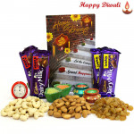 Rich N Dry - Cashew, Raisin, Almond 300 gms in Box, 2 Dairy Milk Fruit & Nut, 2 Dairy Milk Crackle with 4 Diyas and Laxmi-Ganesha Coin
