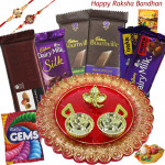 Choco Silky - 2 Bournville, Temptations, Dairy milk Silk, Dairy Milk Fruit & Nut, Dairy Milk Crackle, 1 Gems, Designer Ganesh Thali with 2 Rakhi and Roli-Chawal