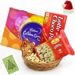 Christmas Festivity - Cashewnuts in Potli, Cadbury Celebrations, Soan Papdi, Chocopie, Basket with Santa Cap and Greeting Card