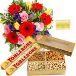 Nice Combo - 15 Mix Seasonal Flowers In Basket + 200 Gms Assorted Dryfruits Box + 2 Toblerone Chocolate Bars + Card