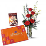 Beautiful Combination - 10 White Orchids & 6 Red Roses in Vase + Cadbury Celebration 162 gms + Card