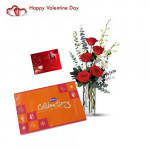 Beautiful Combination - 10 White Orchids & 6 Red Roses in Vase + Cadbury Celebration + Card
