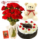 Flowery Treat - 10 Red Roses in Vase, Teddy 6 inch, 1/2 kg Black Forest Cake & Valentine Greeting Card