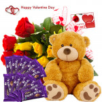 """Delicate Present - 35 Red and Yellow Roses, 12"""" Teddy, 10 Dairy Milk 20gms each and Card"""